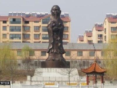 statua buddhista con la testa di Confucio-statua di confucio-cina-repressione libertà religiosa-libertà di religione-aref international onlus